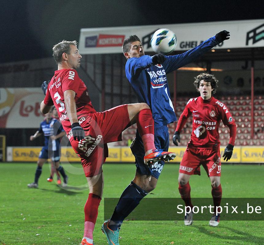 KV Kortrijk - RAEC Mons Bergen : duel tussen Baptiste Martin en Dylan De Belder.foto VDB / BART VANDENBROUCKE
