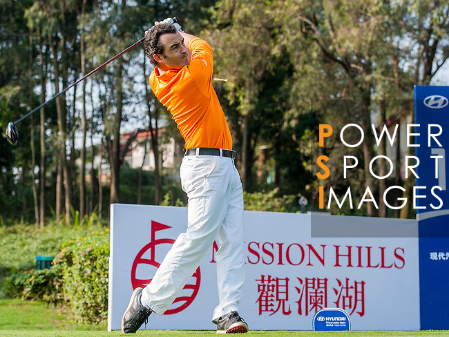 Ivan Ballesteros hits his shot during the Hyundai China Ladies Open 2014 on December 09 2014 at Mission Hills Shenzhen, in Shenzhen, China. Photo by Xaume Olleros / Power Sport Images