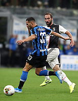 Calcio, Serie A: Inter Milano - Juventus, Giuseppe Meazza stadium, October 6 2019.<br /> Juventus' Gonzalo Higuain (r) in action with Inter's Danilo D'ambrosio (l) during the Italian Serie A football match between Inter and Juventus at Giuseppe Meazza (San Siro) stadium, October 6, 2019.<br /> UPDATE IMAGES PRESS/Isabella Bonotto