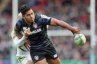 Manu Tuilagi offloads the ball after being tackled. Heineken Cup match, between Leicester Tigers and the Ospreys on October 21, 2012 at Welford Road in Leicester, England. Photo by: Patrick Khachfe / Onside Images