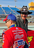 Nov. 20, 2009; Homestead, FL, USA; NASCAR Sprint Cup Series driver Mark Martin (left) talks with former driver Richard Petty during qualifying for the Ford 400 at Homestead Miami Speedway. Mandatory Credit: Mark J. Rebilas-