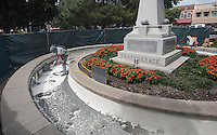 NWA Democrat-Gazette/J.T. WAMPLER Paul Walkingstick of Monet sand blasts layers of paint from the inside of the Confederate memorial fountain on the downtown Bentonville square. The fountain is getting a makeover this week with the old paint being removed and a new, pool specific plaster being applied by Friday. The new interior should last 4-5 years. Walkingstick works for Midwest Pool Interiors.