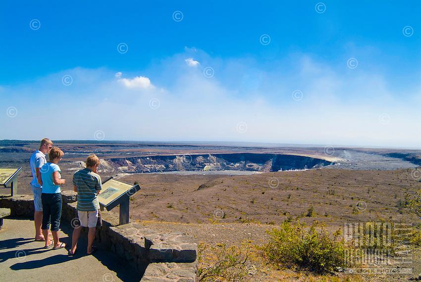 Visitors look over an informational sign at Halema'uma'u Crater before the recent eruption at Hawai'i Volcanoes National Park, Big Island.