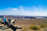 Visitors look over an informational sign at Halema'uma'u Crater before the recent eruption at Hawai'i Volcanoes National Park, Big Island.
