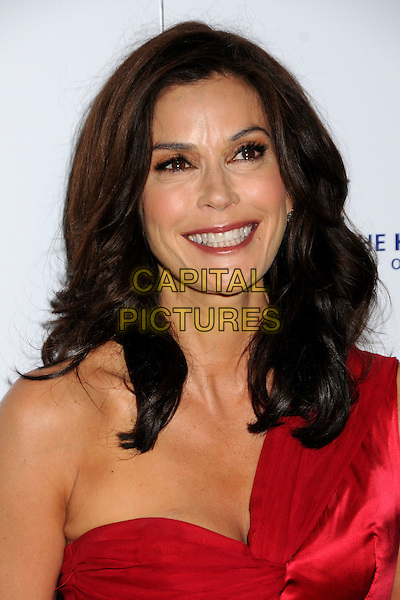 TERI HATCHER.24th Annual Genesis Awards - Arrivals held at the Beverly Hilton Hotel, Beverly Hills, California, USA, 20th March 2010..portrait headshot smiling make-up red one shoulder wrinkles .CAP/ADM/BP.©Byron Purvis/AdMedia/Capital Pictures.