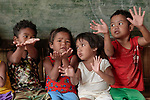 School children in class in Santa Ines, an indigenous village in the Philippines. Their teacher is Lodema Dela Cruz Doroteo, a graduate of Harris Memorial College who benefited from a scholarship from United Methodist Women. She is the first indigenous school teacher in her village.
