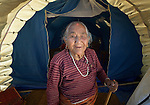 Eighty-five year old earthquake survivor Sardha Shrestha lives in a tent in the village of Sanogoan, Nepal. People in this Newar community, hard hit by the April 2015 earthquake that ravaged Nepal, have been helped by the ACT Alliance to rebuild their lives. The ACT Alliance has provided a variety of services here since the quake, including blankets, tents, and livelihood assistance, and is helping villagers form the tens of thousands of cement blocks they will need to construct permanent housing.
