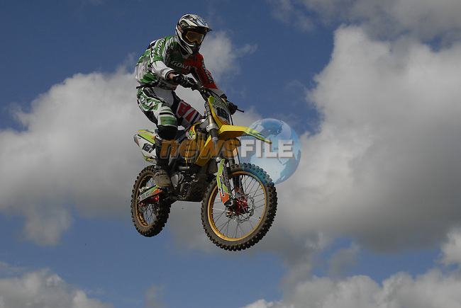 Ross Brown (IRL) flies high over the table top jump in the MX1 Grand Prix Race1 during the Motocross Grand Prix at Fairyhouse Race Course, Co.Meath, Ireland, 31st August 2008.(Photo Eoin Clarke/Newsfile)