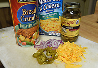 """NWA Democrat-Gazette/FLIP PUTTHOFF <br />Extra ingredients, including chopped onion, jalapeno and grated cheddar, stand ready to """"doctor up"""" a box of macaroni and cheese."""