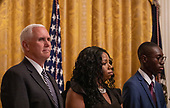 United States Vice President Mike Pence listens to US President Donald J. Trump deliver remarks at the Young Black Leadership Summit 2019 at the White House in Washington, D.C. on Friday October 4, 2019.  <br /> Credit: Tasos Katopodis / Pool via CNP