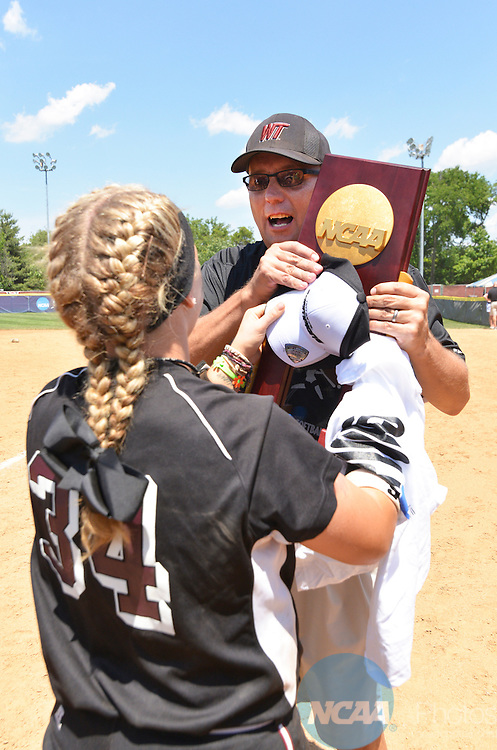 26 MAY 2014: Renee Erwin (34) hands her coach, Kevin Blaskowski the Championship Trophy after they won the school's first Division II softball championship at the Division II Women's Softball Championship held at the Moyer Sports Complex in Salem, VA.  West Texas defeated Valdosta State 3-2 for the national title.  Andres Alonso/NCAA Photos