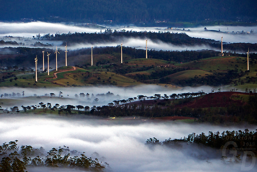Sunrise and wind-farms over mountains in Nuwara Eliaya shrouded in clouds, Sri Lanka