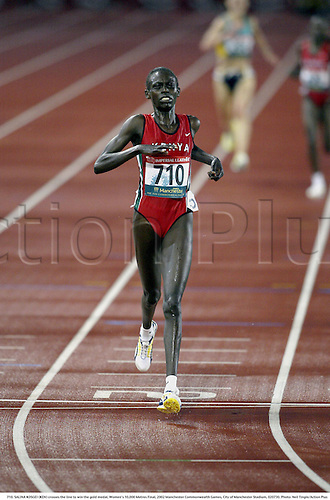 710. SALINA KOSGEI (KEN) crosses the line to win the gold medal, Women's 10,000 Metres Final, 2002 Manchester Commonwealth Games, City of Manchester Stadium, 020730. Photo: Neil Tingle/Action Plus...athletics athletes athlete.runner runners run running.track event distance.winner winners.woman......................................