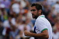 Marin Cilic of Croatia celebrates after winning the second set against Roger Federer of Switzerland during men semifinal match at the US Open 2014 tennis tournament in the USTA Billie Jean King National Center, New York.  09.05.2014. VIEWpress