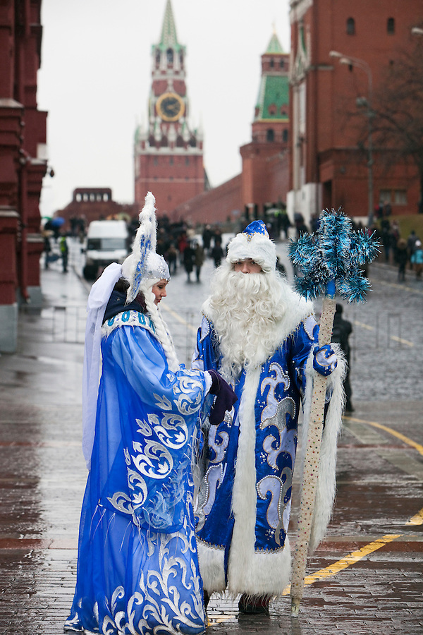 Moscow, Russia, 07/01/2012..Ded Moroz and Snegurochka - Father Frost and the Snow Princess - stand in front of Red Square in pouring rain on Orthodox Christmas Day. Record high winter temperatures have left the Russian capital almost devoid of snow during the lengthy New Year holidays, and for the first time in living memory here has been no white Christmas in Moscow.
