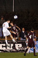 Ohio State Buckeyes defender Tim Gabel (18) and University of Massachusetts Minutemen defender Kenny Cook (21) go up for a header during an NCAA College Cup semi-final match at SAS Stadium in Cary, NC on December 14, 2007. Ohio State defeated Massachusetts 1-0.