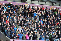 SWANSEA, WALES - FEBRUARY 21: Swansea supporters watch the game during the Barclays Premier League match between Swansea City and Manchester United at Liberty Stadium on February 21, 2015 in Swansea, Wales.