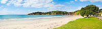 Panoramic Photo of Oneroa Beach, Waiheke Island, Auckland, North Island, New Zealand. Waiheke Island is a stunning island just 40 minutes ferry ride from the Auckland ferry terminal. It is an extremely popular island and holiday destination with both local New Zealanders and foreign tourists alike thanks to its 15 vineyards, beautiful beaches and picturesque scenery and walks. The Fullers Waiheke Island Explorer Tour is a great way to see a large part of the island, and at c.$40 (just over £20) including the ferry, its a great, affordable option.
