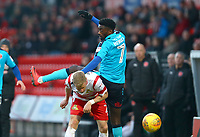 Jordy Hiwula of Fleetwood Town high challenge on Craig Alcock of Doncaster Rovers during the Sky Bet League 1 match between Doncaster Rovers and Fleetwood Town at the Keepmoat Stadium, Doncaster, England on 17 February 2018. Photo by Leila Coker / PRiME Media Images.