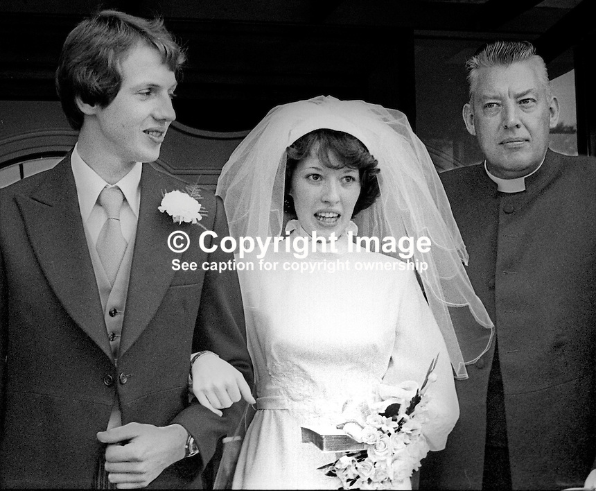 Rev Ian Paisley with his daughter, Sharon, and her husband, John Huddleston, after their wedding in Martyrs Memorial Free Presbyterian Church, Belfast, N Ireland, 7th July 1977, at which he officiated. 197707000153a<br />