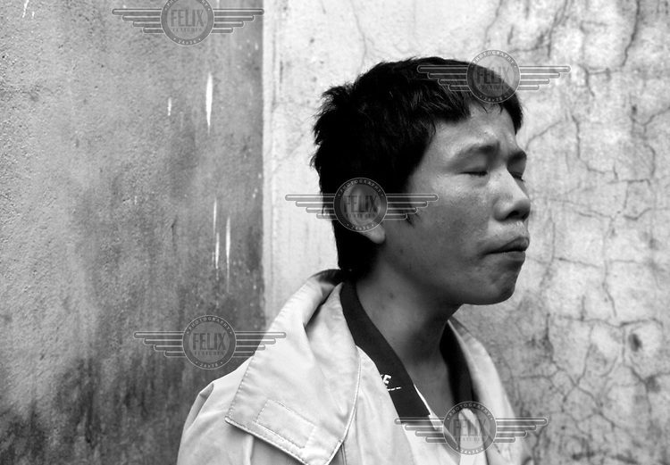Nguyen Dinh Thuyen (24) sings about a mother he has never known in  Haiphong, Vietnam on October 21, 2000. He pays for his heroin addiction by selling used syringes to other users. He says he has never been tested, but is certain he is HIV positive. Worldwide, more than 20 million people have died since the first cases of AIDS were identified in 1981.