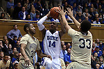 31 December 2014: Duke's Rasheed Sulaimon (14) is defended by Wofford's Jaylen Allen (20) and Cameron Jackson (33). The Duke University Blue Devils hosted the Wofford College Terriers at Cameron Indoor Stadium in Durham, North Carolina in a 2014-16 NCAA Men's Basketball Division I game.