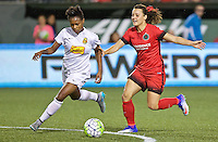 Portland, Oregon - Sunday September 11, 2016: Western New York Flash defender Taylor Smith (11) and Portland Thorns FC forward Hayley Raso (21) fight for the ball during a regular season National Women's Soccer League (NWSL) match at Providence Park.