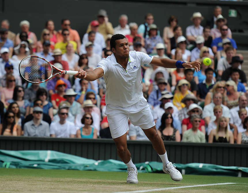 Jo-Wilfried Tsonga (FRA) in action today during his Gentlemen's Singles Quarterfinal match against Roger Federer (SUI)...