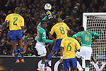 20 JUN 2010:  Julio Cesar (BRA)(behind) fists the ball away from the box as Kolo Toure (CIV)(4) and Salomon Kalou (CIV)(8) apply pressure, and Gilberto Silva (BRA)(8), Michel Bastos (BRA)(6), and Maicon (BRA)(2) support the defense.  The Brazil National Team led the C'ote d'Ivoire National Team 1-0 at the end of the first half at Soccer City Stadium in Johannesburg, South Africa in a 2010 FIFA World Cup Group G match.