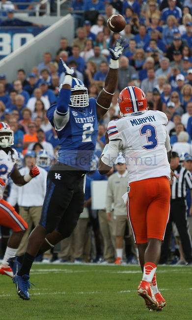 Kentucky Wildcats defensive end Alvin Dupree (2) attempts to block a pass from Florida Gators quarterback Tyler Murphy (3) to running back Matt Jones (24) during the first half of the UK vs. UF football game at Commonwealth Stadium in Lexington, Ky., on Saturday, September 28, 2013. Photo by Tessa Lighty   Staff