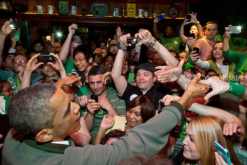 United States President Barack Obama greets the crowd at the Dubliner, an Irish pub in Washington, D.C., on St. Patrick's Day, Saturday, March 17, 2012..Mandatory Credit: Pete Souza - White House via CNP