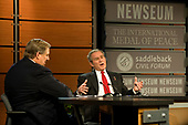 United States President George W. Bush participates in the Saddleback Civil Forum on Global Health at the Newseum with Rick Warren, left,  in Washington, D.C., Monday, December 1, 2008.<br /> Credit: Mannie Garcia / Pool via CNP