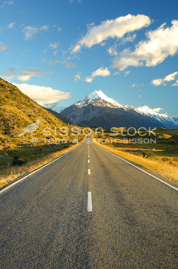 View of the road leading to  Mount Cook in the background, at sunrise, McKenzie Country, South Island