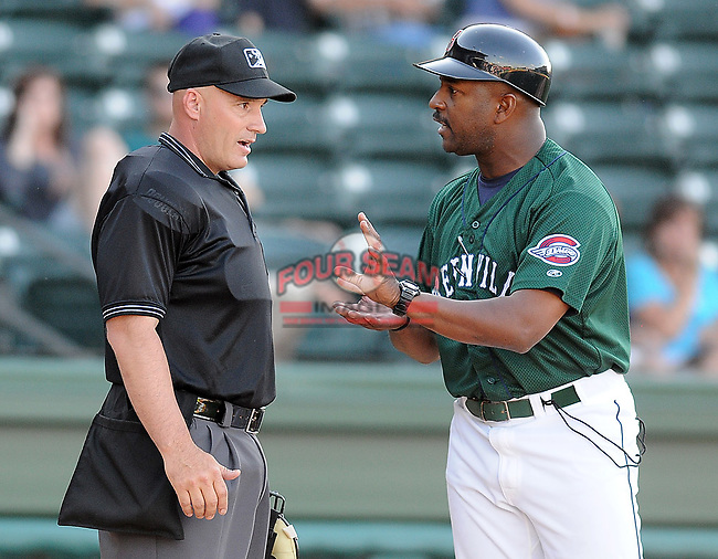 Manager Billy McMillon (51) of the Greenville Drive unsuccessfully argues a call with home plate umpire Brian Richardson during a game against the Lexington Legends April 25, 2010, at Fluor Field at the West End in Greenville, S.C. Photo by: Tom Priddy/Four Seam Images