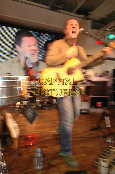 DIRTY VEGAS.At HMV Oxford Circus, 150 Oxford Street, London, W1 playing live set and signing copies of their new album 'One'.October 19th, 2004.music, band, stage, gig, live, full length, guitar, singing.www.capitalpictures.com.sales@capitalpictures.com.©Capital Pictures