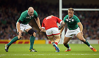Pictured: John Moonlight of Canada (C) comes against Paul O'Connell  (L) and Luke Fitzgerald (R)of Ireland Saturday 19 September 2015<br /> Re: Rugby World Cup 2015, Ireland v Canada at the Millennium, Stadium, Wales, UK