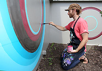 NWA Democrat-Gazette/DAVID GOTTSCHALK  Matt Miller, of Fayetteville, continues to paint Wednesday, June 14, 2017, on the north east corner of the Arts Center of Ozarks in Springdale. The mural will cover roughly 210 square feet. The center will offer a street art class July 10-14 as part of their summer art camp series. Students go from sketches to conception creating a mural on the center's exterior building wall.