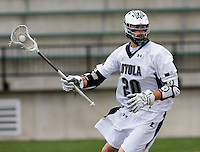 Collin Finnerty (20) of Loyola looks for a teammate at the Ridley Athletic Complex in Baltimore, MD.  Loyola defeated Georgetown, 11-6.