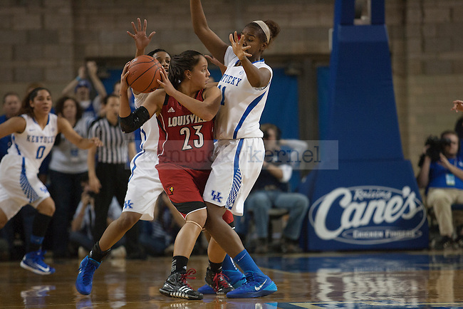 Kentucky Wildcats forward DeNesha Stallworth (11) and guard Bria Goss (13) defend Louisville Cardinals guard Shoni Schimmel (23) during the second half of the University of Kentucky vs. University of Louisville women's basketball game at Memorial Coliseum in Lexington, Ky., on Sunday, December 1, 2013. Kentucky defeated Louisville 69-64.Photo by Michael Reaves   Staff