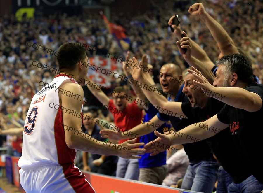Kosarka Kosarkaska Liga Srbije season 2014-2015<br /> Crvena Zvezda v Partizan<br /> Luka Mitrovic (L) celebrate with the fans supporters navijaci<br /> Belgrade, 05.17.2015.<br /> foto: Srdjan Stevanovic/Starsportphoto &copy;