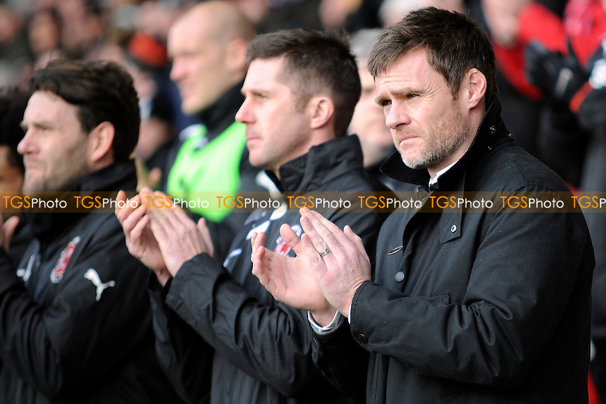 Fleetwood Town manager Graham Alexander and former Preston North End player observes the minites applause for Sir Tom Finney - Fleetwood Town vs Northampton Town - Sky Bet League Twol Football at Highbury Stadium, Fleetwood, Lancashire - 15/02/14 - MANDATORY CREDIT: Greig Bertram/TGSPHOTO - Self billing applies where appropriate - 0845 094 6026 - contact@tgsphoto.co.uk - NO UNPAID USE