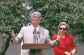 United States President Bill Clinton speaks to members of the League of Women Voters in the Rose Garden of the White House in Washington, D.C. on June 7, 1993.   First lady Hillary Rodham Clinton looks on from the right.<br /> Credit: Ron Sachs / CNP