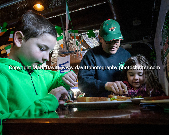 Founder's Irish Pub held its annual St. Patricks Day Kegs and Eggs featuring green eggs and ham and green beer in Bondurant March 17. Breakfast is delivered to a smiling Kasey Burke, 6 of Pleasant Hill. She was there with her dad Brian and brother, Chase, 9.
