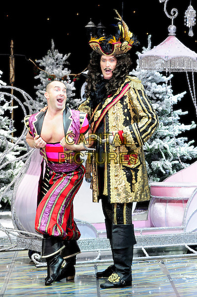 LOUIE SPENCE & DAVID HASSELHOFF .First Family Entertainment theatre company's annual group Pantomime photocall at Piccadilly Theatre, London, England..November 26th, 2010.stage costume panto pantomime full length pink red gold wig captain hook flashing chest funny mouth open side jacket trousers .CAP/CAS.©Bob Cass/Capital Pictures.