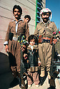 Iran 1979.A little girl and two peshmergas posing for a picture in Mahabad