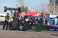 Feb. 22, 2013; Chandler, AZ, USA; NHRA crew members for top fuel dragster driver Leah Pruett during qualifying for the Arizona Nationals at Firebird International Raceway. Mandatory Credit: Mark J. Rebilas-