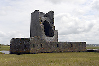 Carrigafoyle Castle at the mouth of the River Shannon, near Ballylongford in County Kerry was referred to as the &lsquo;Guardian of the Shannon&rsquo; because of its strategic location overlooking the shipping lanes that supplied the city of Limerick. The castle was built in the 1490s by Conor Liath O&rsquo;Connor. The name Carrigafoyle derives from the Irish Carrig an Phoill, meaning &lsquo;rock of the hole&rsquo;. The castle consists of a single tower, over 24m in height. During the rebellion of Gerald Fitzgerald, 15th Earl of Desmond the castle was fortified with a garrison of fifty Irish and sixteen Spanish soldiers, who had arrived in Ireland in 1579. The castle was attacked during Easter 1580 by government forces under Sir William Pelham, Lord Justice of Ireland. Tradition recounts the siege as seeing one of the first uses of artillery fire-power in Kerry. On the first day Pelham ordered troops to cross to the sea-wall, where they were pinned down by gunfire and had boulders thrown at them from the battlements. On the second day government reinforcements arrived. The castle walls cracked under the impact of a few shots of cannon and the west wall collapsed, crushing many inside. The remaining occupants of the castle were subsequently put to death.<br /> Photo: Don MacMonagle <br /> e: info@macmonagle.com