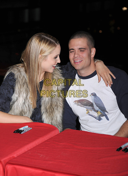 'Glee' star Mark Salling is reported dead at 35 of apparent suicide. He was awaiting sentencing on child pornography charges.<br /> ***FILE PHOTO***Dianna Agron and Mark Salling at the Glee Season One cd release at Borders Columbus Circle in New York City. November 3, 2009.. <br /> CAP/MPI/DVT<br /> &copy;DVT/MPI/Capital Pictures