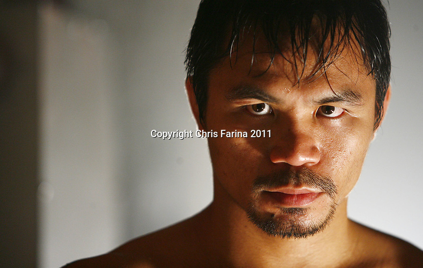 "9/1/10,New York,N.Y.  --- ""SEE YOU ON NOV 13"" --- Superstar Manny Pacquiao(pictured) squares off with three-time world champion Antonio Margarito of Tijuana,MX during a Top Rank studio photo shoot for their upcoming mega fight. Pacquiao and Margarito will do battle, November 13 at Cowboys Stadium in Arlington,Texas. Pacquiao vs Margarito is promoted by Top Rank in association with MP Promotions and Cowboys Stadium. This telecast will be available live on HBO Pay Per View.   --- Photo Credit : Chris Farina - Top Rank  (no other credit allowed)  copyright 2010"