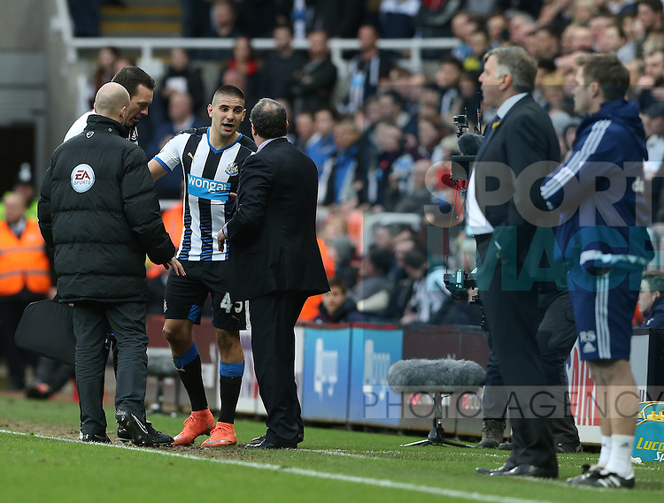 Newcastle United's Aleksandar Mitrovic, center, is not allowed backed on to the pitch during the Barclays Premier League match at St James' Park Stadium. Photo credit should read: Scott Heppell/Sportimage